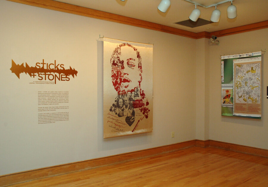 The entrance to the Sticks + Stones exhibit. Shows a poster with a face.