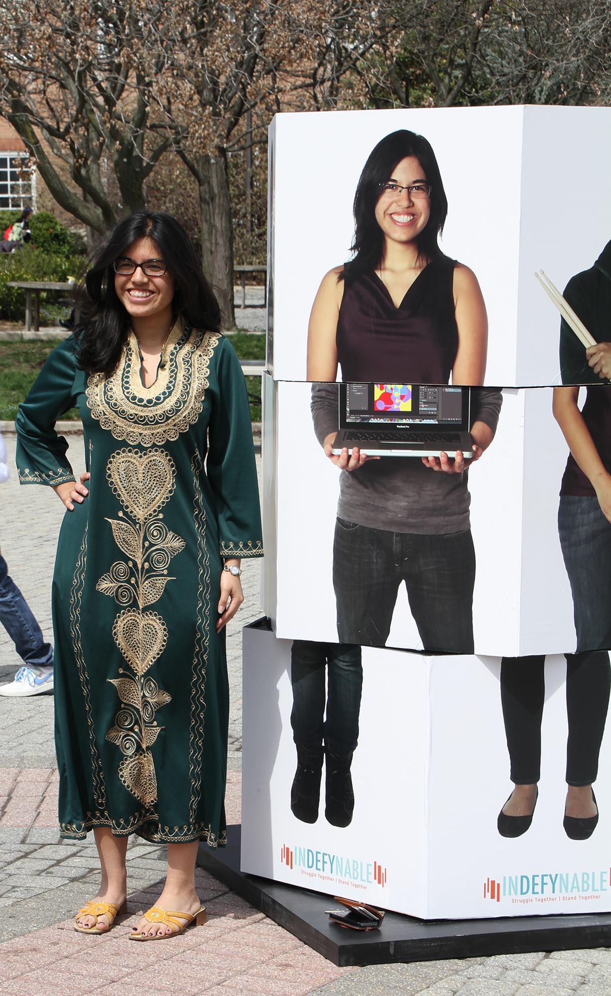 APA student beside her image on the pillar