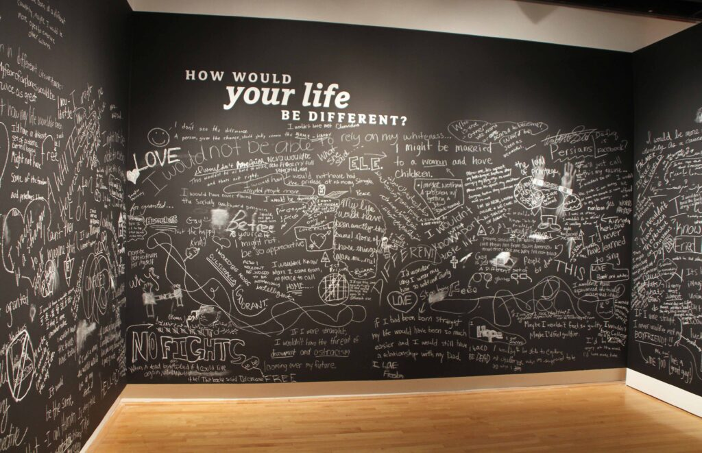 A chalkboard with thoughts written on it in chalk.